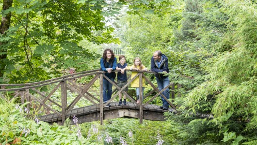 Family on Bridge at Armadale Castle gardens